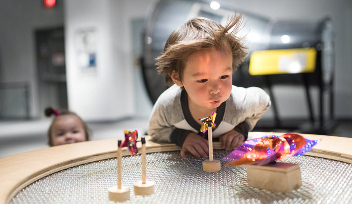 A boy conducts an experiment a the Launch Lab