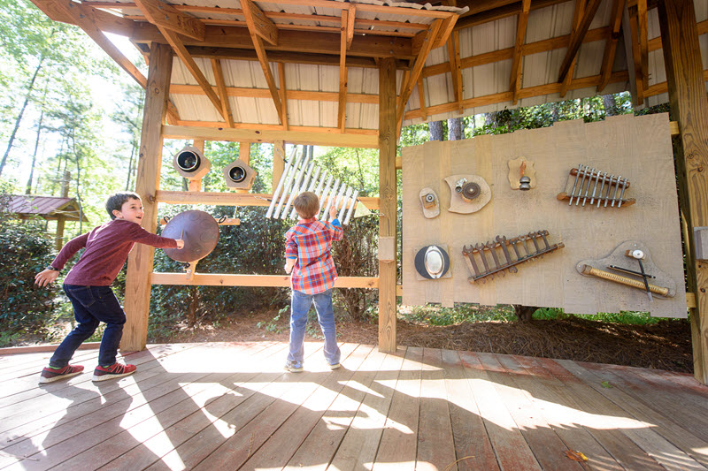 Two boys make music in the sound garden