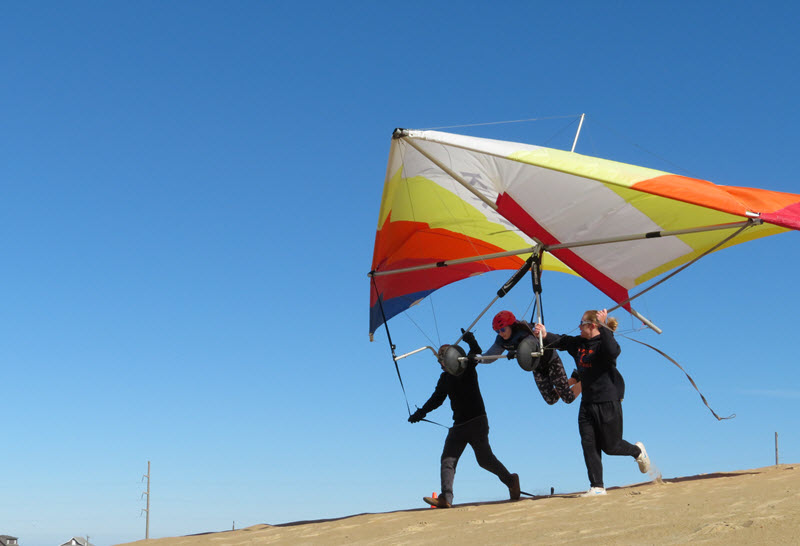 Middle-school girl takes a hang gliding lesson